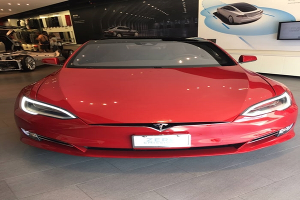 Model S is exhibited at a Tesla store that is located at a huge shopping center in Los Angeles.