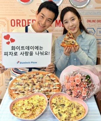 피자배달 전문 기업 `도미노피자`는 화이트데이를 맞아 3월 14일 하루 동안 온라인에서 방문포장 주문 때 봄 신제품 `더블크러스트 치즈멜팅 피자`를 포함한 모든 피자와 사이드디시 화이트 리조또 또는 화이트 크림 스파게티를 40% 할인된 가격에 제공한다. 사진=도미노피자 제공
