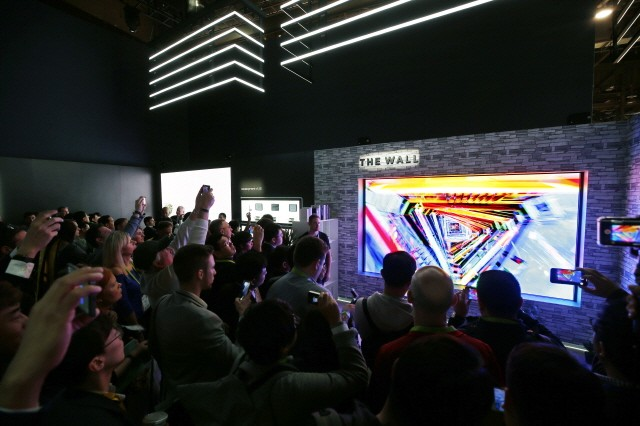 Samsung plans to dominate the extra-large premium TV market with its two-track strategy that includes its '8K AI QLED TV' and 'The Wall'. Shown in the image is 'The Wall' Samsung unveiled at the CES.