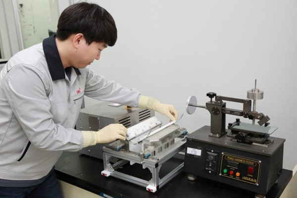 SKC's researcher is demonstrating folding process of transparent PI film (Reference: SKC)