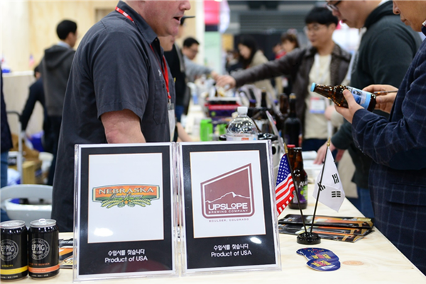 A representative from an American beer brewery is explaining company's products at KIBEX 2019 that was held at aT Center.