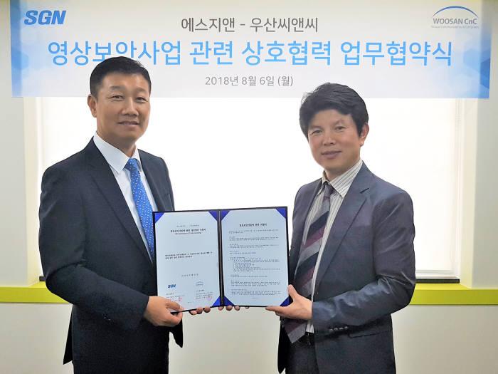 강현모 에스지앤 대표(왼쪽)와 국중교 우산씨앤씨 대표.