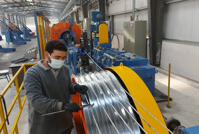 An employee produces cables at LS Cable & System's Egypt plant (LSMC).