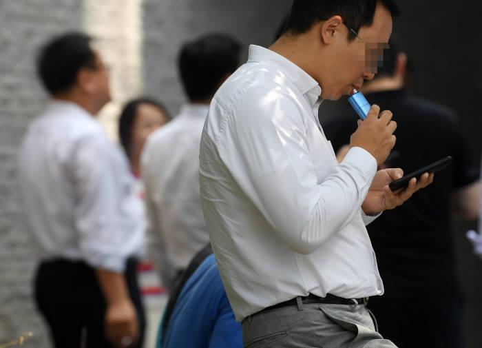 연이은 전자담배 폭발 사고…'아이코스·글로·쥴·릴' 안전성은?