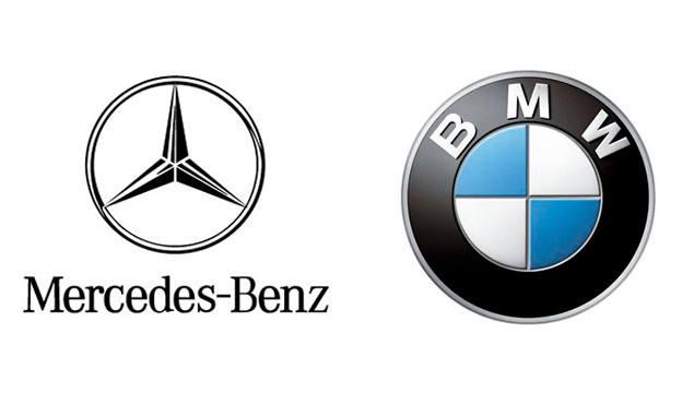 메르세데스-벤츠와 BMW 로고.