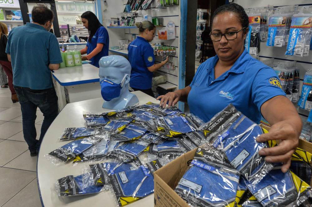 A worker at a medical supply store organizes PFF-2 respirator mask that customers are buying as a precaution against the spread of the new coronavirus, the COVID-19, in Sao Paulo, Brazil, on February 27, 2020. (Photo by Nelson ALMEIDA / AFP)