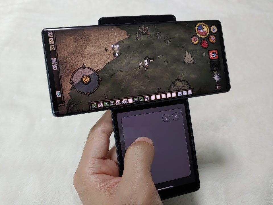 LG 윙 세컨드 스크린으로 커서를 움직일 수 있는 LG 터치 패드 기능